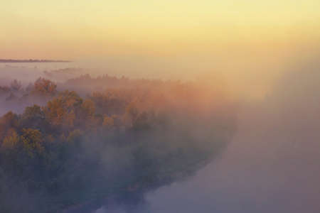 The foggy and mysterious view of the Bug River in Poland near Drohiczyn. Popular among Poles, the area is a place for their leisure, water sports, angling and nature. There are also many sights.