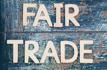 Photo pour Fair trade written on rustic wooden surface - image libre de droit