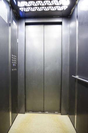 Foto de interior of a modern silvery elevator - Imagen libre de derechos