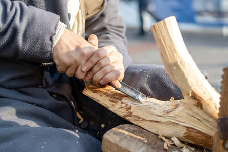 Photo pour a man is engaged in wood processing, handmade - image libre de droit