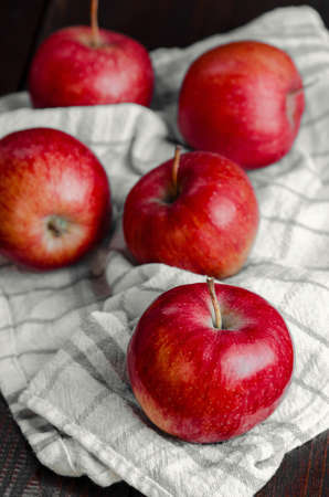 Photo for Juicy red apples on white napkin, still life, closeup - Royalty Free Image