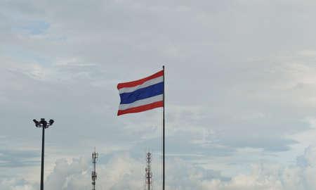 Thai flag waving against evening sky