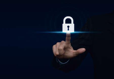 Photo pour Businessman pressing security button icon, Technology information security and data encryption concept - image libre de droit