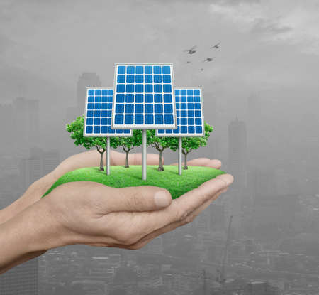 Solar cell in man hands over pollution city with birds, Ecological energy concept
