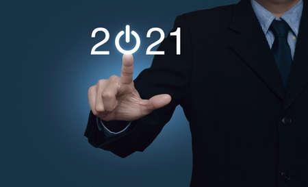Photo pour Businessman pressing 2021 start up business flat icon over gradient light blue background, Business happy new year cover concept - image libre de droit