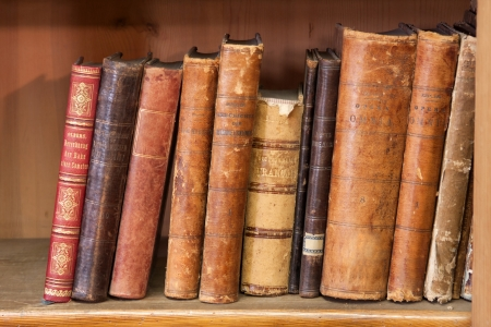 a stack of very old books on the shelf