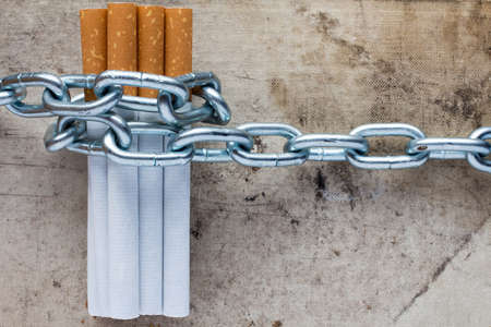 Chained cigarettes. Conceptual image for stop smoking