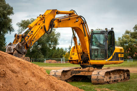Photo for Excavator during earthmoving at construction site. Ð¡onstruction machinery for excavation. - Royalty Free Image