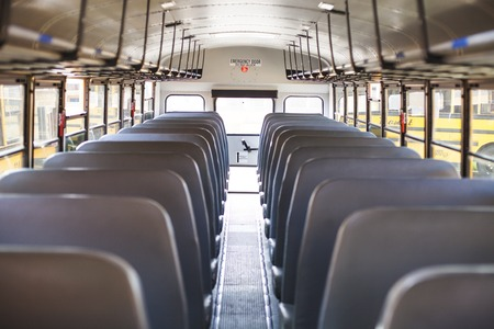 Photo pour Inside school bus: line of seats. Back to school concept. Educational time - image libre de droit