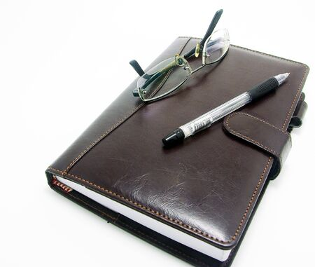 day planner with eyeglass and pen for business