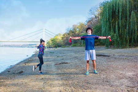 Cardio exercise - Sports couple training outdoors together
