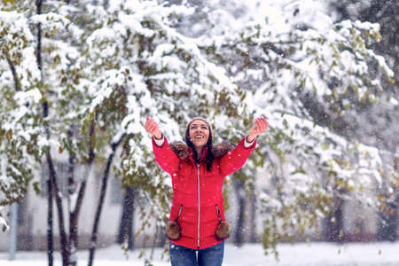 Photo pour Winter holiday and people concept -Happy  Girl enjoying in the snow - image libre de droit