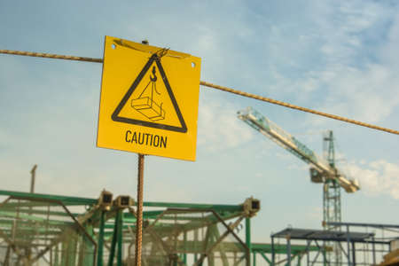 Caution sign at a construction site warns visitors of area
