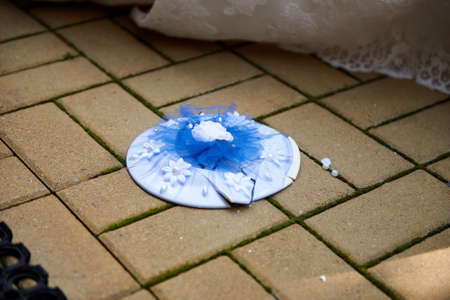 Foto de Breaking plates on wedding popular tradition. Plate on floor - Imagen libre de derechos