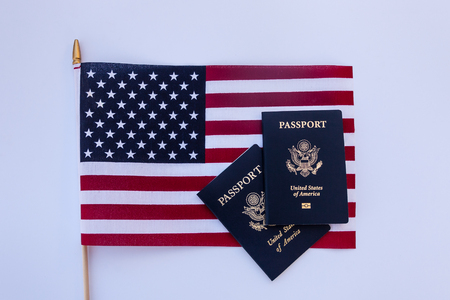 USA flag with two passports on a solid background