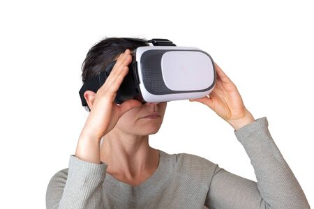 Photo pour Caucasian woman wearing virtual reality headset and holding. Isolated on white with copy space - image libre de droit
