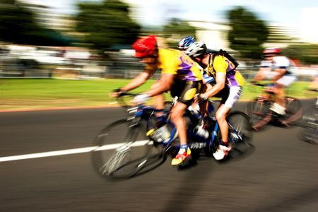 Tandem Cyclists competing at high speed with motion blur