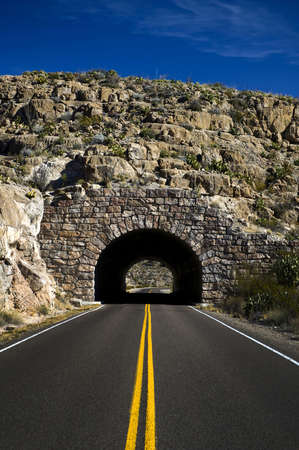 Image of a highway heading into a tunnel