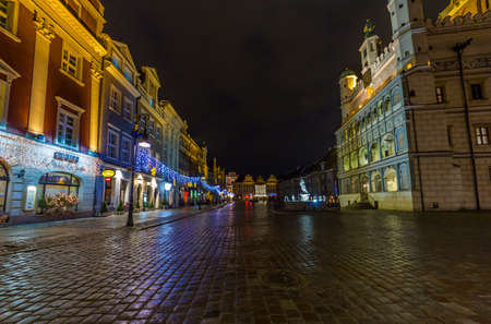 Photo for Poznan, Poland - Janurary 10, 2014  Night photo of  historical town square with beautifully decorated townhall on the right and old houses on the left on Janurary 10, 2014  - Royalty Free Image