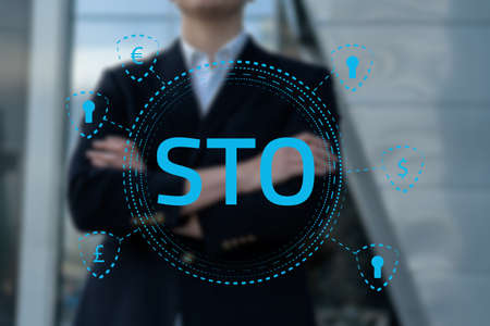Security Token Offering STO cryptocurrency and blockchain concept, businessman pressing virtual graphics on virtual screens