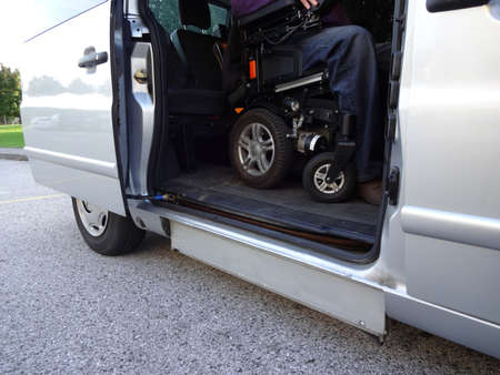 Photo pour Disabled Men on Wheelchair using Accessible Vehicle with Lift - image libre de droit