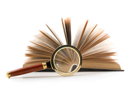 Magnifying glass and opened book, isolated on white background.