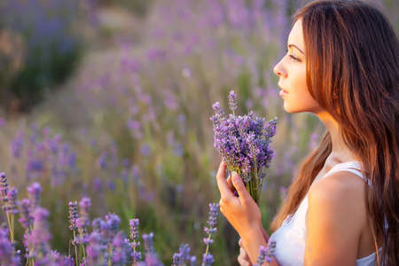 smiling beautuful brunette in the lavender fieldの写真素材