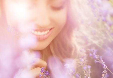 Photo for Beautiful young woman portrait in lavender field - Royalty Free Image