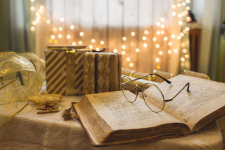 Photo for Holy bible book with eyeglasses. Christmas lights on background. - Royalty Free Image