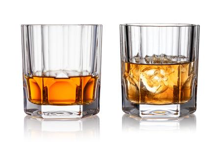 Foto de Glass of whisky and ice isolated white background - Imagen libre de derechos