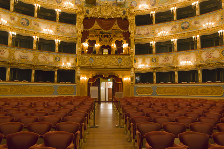 Venice, Italy June 5, 2014: Interior of La Fenice Theatre. Teatro La Fenice, The Phoenix, is an opera house, one of the most famous and renowned landmarks in the history of Italian theatre