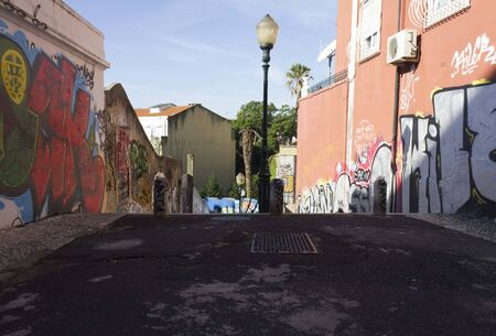 LISBON, PORTUGAL - OCTOBER 25 2014: Calcada do Lavra street in Lisbon with its graffiti and nobody around