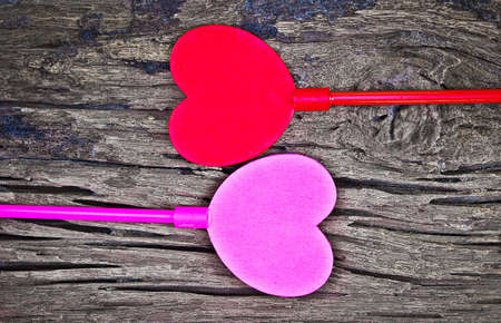 Two hearts on old wooden background. Valentines day background.