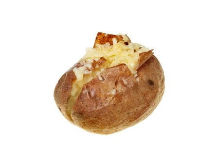 Baked potato topped with melted grated Cheddar cheese isolated against white