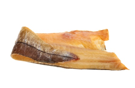 Fillet of smoked haddock isolated against white