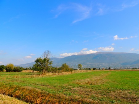 Landscape of Umbrian country with Monte Subasio in the background, Italy