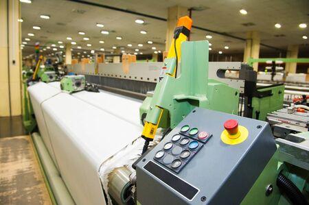 Photo pour Industrial fabric production line. Weaving looms at a textile factory - image libre de droit