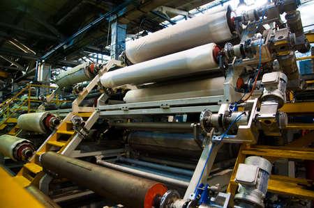 Photo pour Manufacture of tires. Tire production machine conveyor - image libre de droit