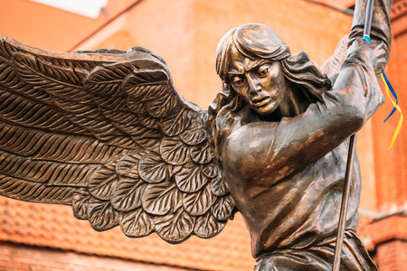 Close Up Detail Of Statue Of Archangel Michael With Outstretched Wings, Thrusting Spear Into Dragon Before Catholic Church Of St. Simon And St. Helena On Independence Square In Minsk, Belarus