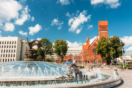 Church Of Saints Simon And Helen - Red Church - And Fountain At Independence Square In Minsk, Belarus