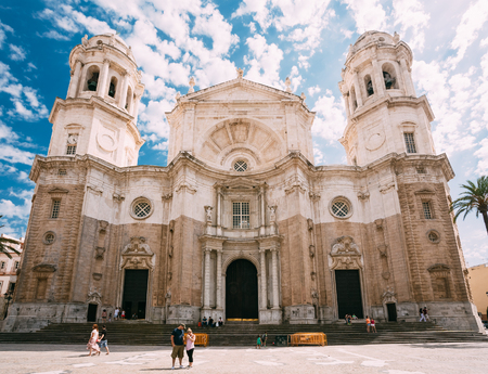 Cadiz, Spain - June 21, 2015: People walking near Cathedral in Cadiz, Spain. Sunny day. It was built between 1722 and 1838.