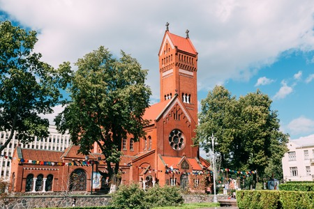 MINSK, BELARUS - AUGUST 27, 2014: Belarussian Roman Catholic Church Of Saints Simon And Helen or Red Church On Independence Square In Minsk, Belarus