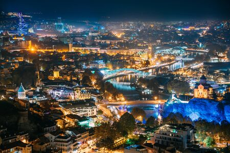 Photo for Tbilisi, Georgia. Top View Of Georgian Capital City Skyline Cityscape In Night Illuminations. - Royalty Free Image