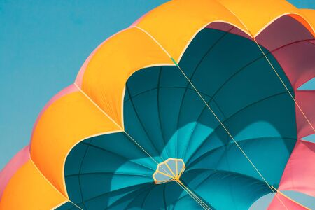 Photo for Close Multi-colored Parachute For Parasailing On Background Of Blue Sky. - Royalty Free Image