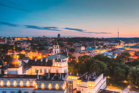 Photo for Vilnius, Lithuania, Eastern Europe. Aerial View Of Historic Center Cityscape In Blue Hour After Sunset. Old Town In Night Illuminations. - Royalty Free Image
