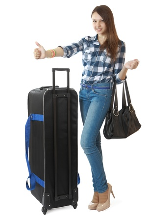 Teen girl with a big, black travel bag on wheels