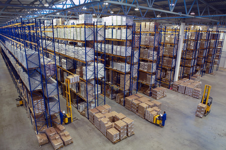 St. Petersburg, Russia - November 21, 2008: Interior warehouse storage, vertical storage, pallets on shelves overhead racks, interior large warehouse with freight stacked high.