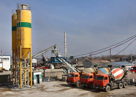 St. Petersburg, Russia - April 27, 2009: A concrete batching plant for ready-mix concrete truck, industrial production concrete, concrete batch plant manufacturer,  truck mixer stands on site of the concrete plant.