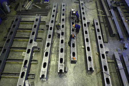 St. Petersburg, Russia - May 18, 2015: Structural steel fabrication process, steel construction, manufacturing building beams at a metal factory.