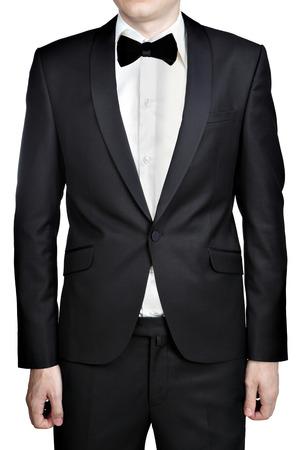 Dark gray evening dress for men; blazer; white shirt; bow tie; isolated over white background.